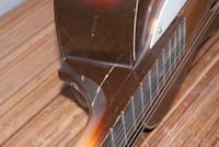 Reparatie gebroken hals akoestische gitaar