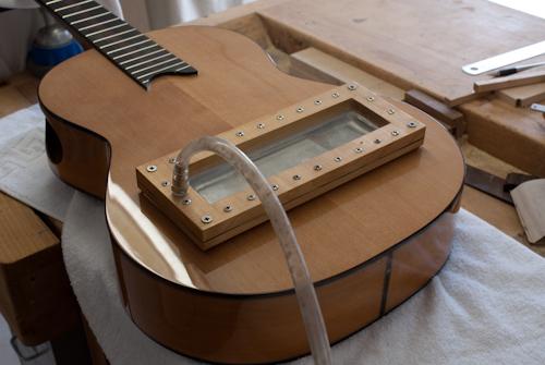 reparatie brug gitaar